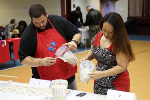 Filling tasting cups, Coquito Masters final, Taino Towers, East 123rd Street, Manhattan-001